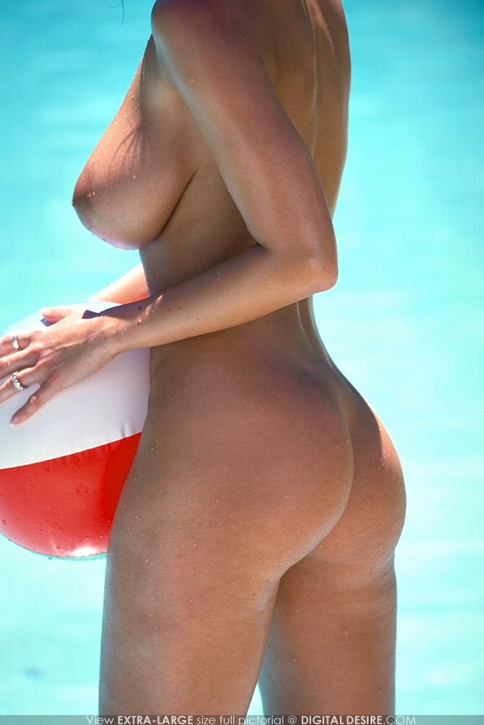 Latina in bikini by a pool