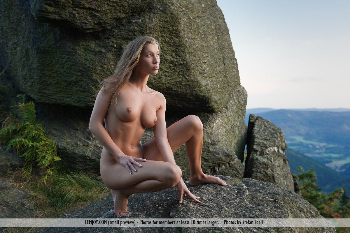 Nude rock climbing girl
