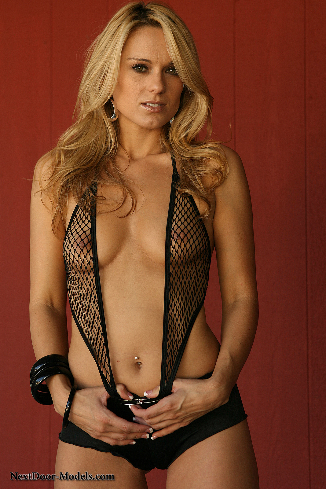 Blonde stripping in fishnet stockings and garter belt 7