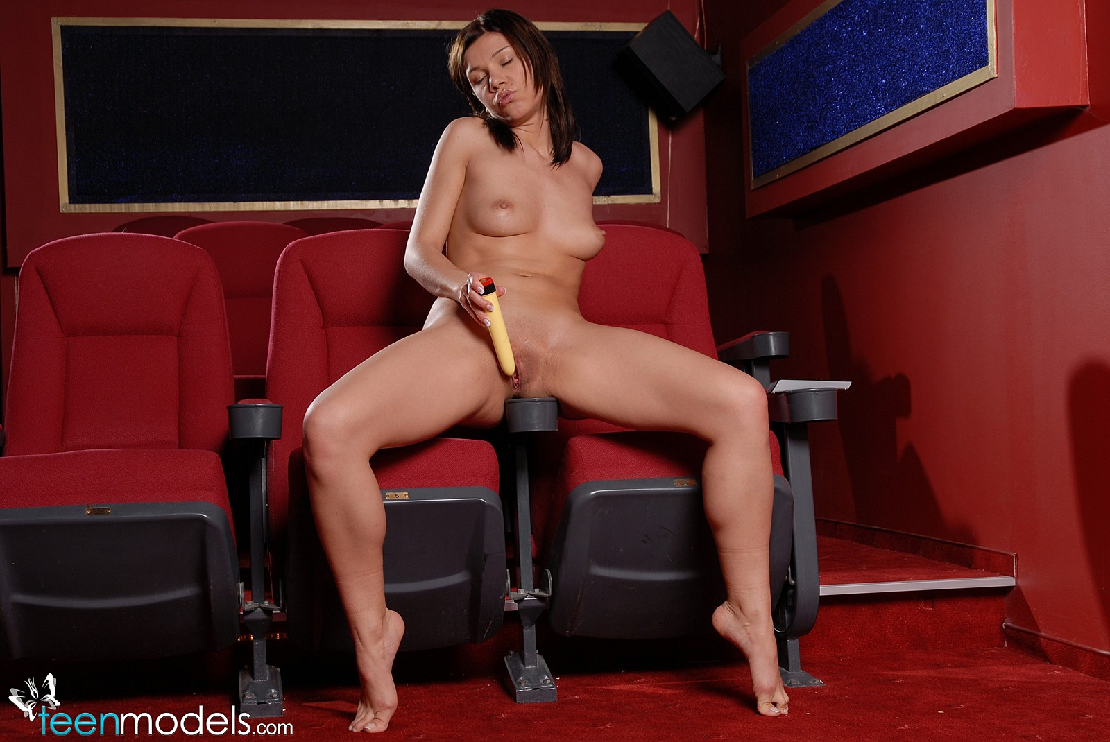 Girl masturbating in movie theater