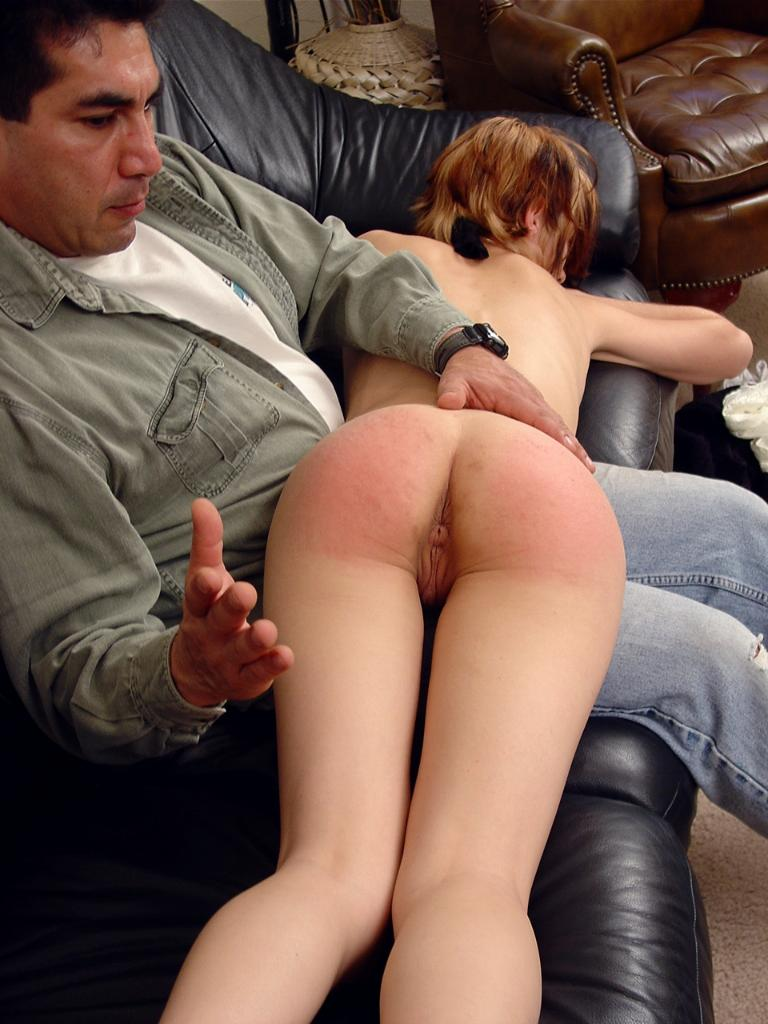 nude woman gets spanked